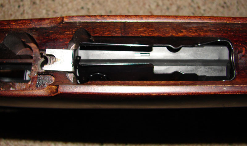 New center-feed magazine.  Note the small bracket to the rear which serves two purposes:  setting the height of the rear of the magazine box and applying tension to keep the front of the magazine box on it's lip.