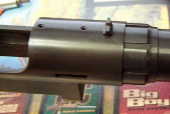 Rear sight is non-adjustable and attached to the action with a screw.