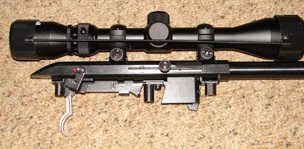 Side view of action showing the trigger assembly and magazine well arrangement.