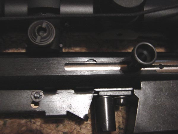 Close-up of the bolt hold-open relief cut and charging handle.