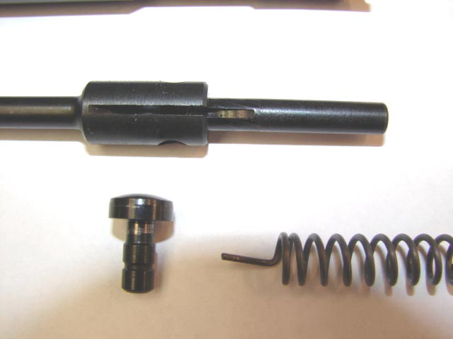 Close-up of the cocking piece, firing pin spring and tail of the firing pin.
