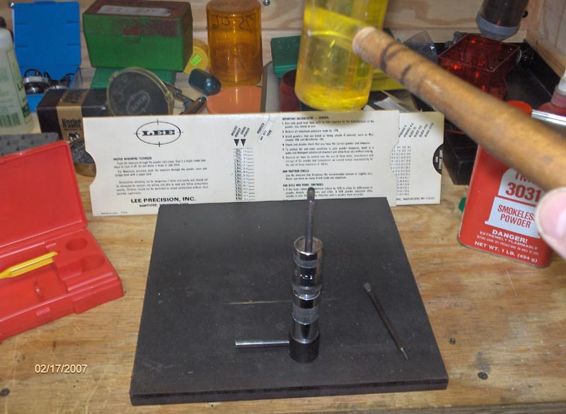 Step 3:  Re-prime the case, set a primer in the priming tray and seat by tapping with the flat face priming rod.
