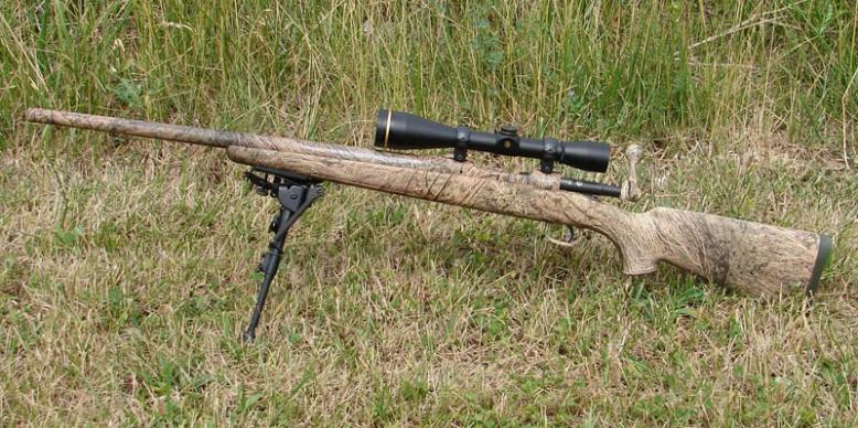 The camouflage pattern used on the Predator Hunter works very well in masking the rifle's profile in a grassy environment.
