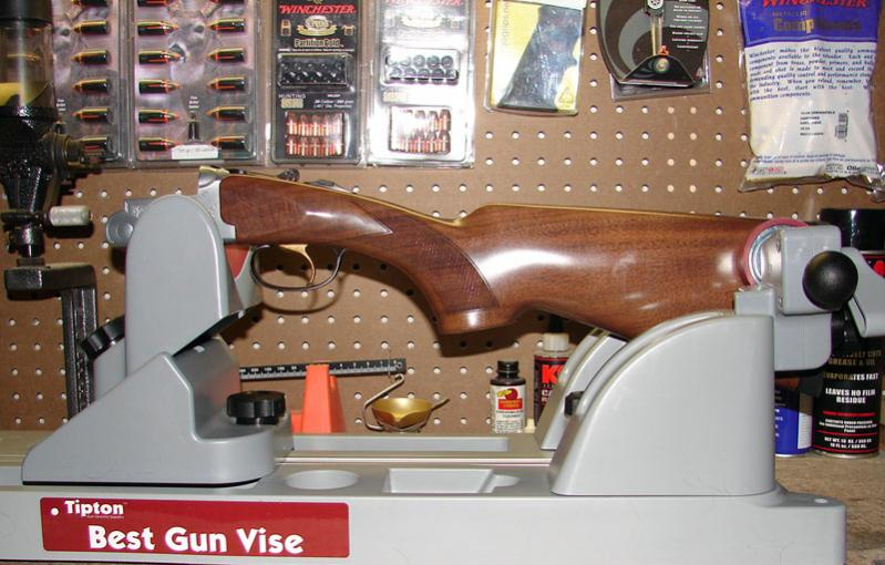 A better option for break-action firearms is to disassemble them and only place the barrel or receiver half in the vise.  This provides a much more secure and stable working platform.